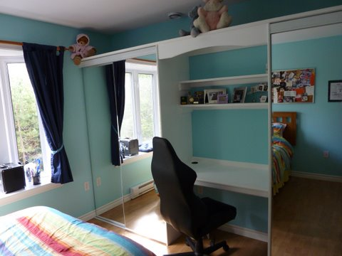 Bedroom built-in closet with mirrors